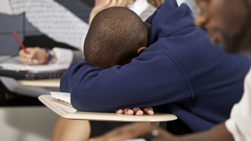 Teenage boy tired at school. (Arthur Carlo Franco, iStock via Getty Images ** OUTS - ELSENT and FPG