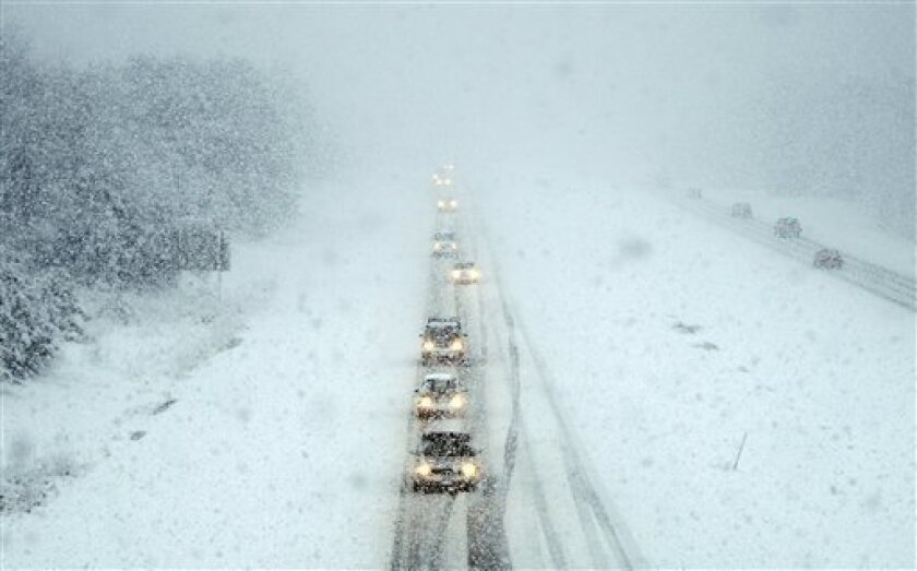 Motorists make their way north during a spring snowstorm on Interstate 295 in Freeport, Maine, Friday, April 1, 2011. (AP Photo/Robert F. Bukaty)
