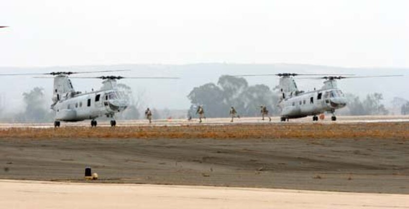 U.S. Marines exit CH-46 Sea Knight Helicopters during the annual air show aboard Marine Corps Air Station (MCAS) Miramar. Photo: U.S. Marine Corps Sgt. Keonaona C. Paulo, Courtesy DefenseImagery.mil