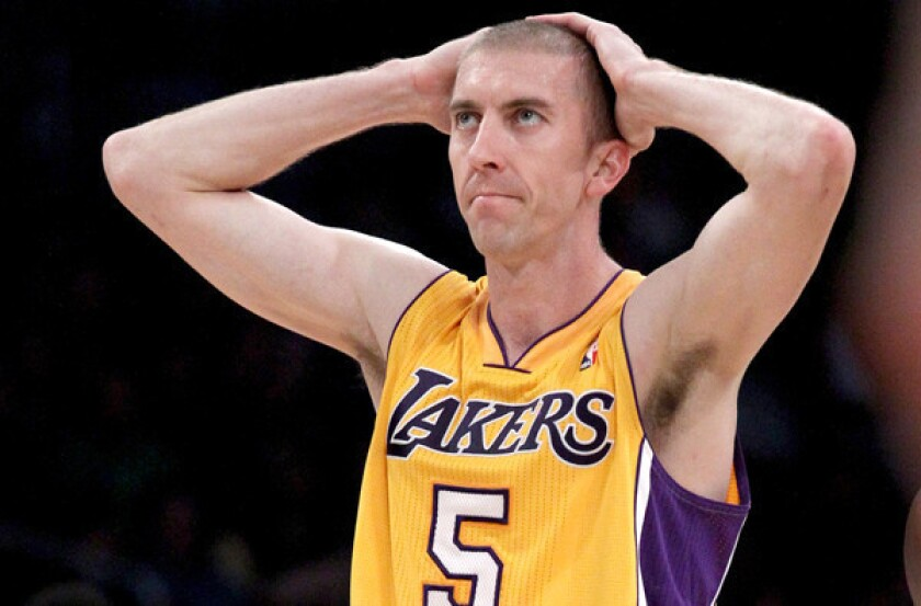 Lakers guard Steve Blake reacts after committing a foul against the Warriors during an early-season game at Staples Center.