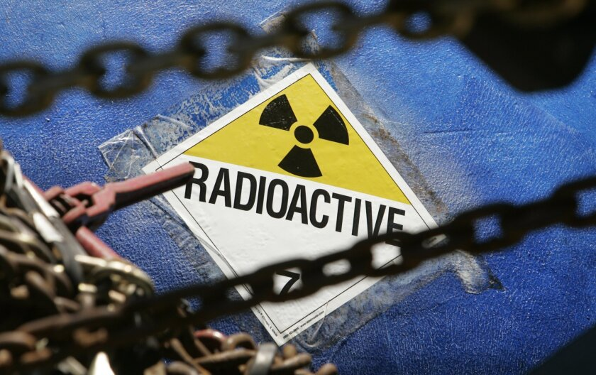 A radioactive sticker on part of a low-level radioactive steam generator being transported to Utah for disposal by a 399-foot long truck, which made a scheduled stop on Oceanside Boulevard Monday while on the way from the San Onofre nuclear power plant.
