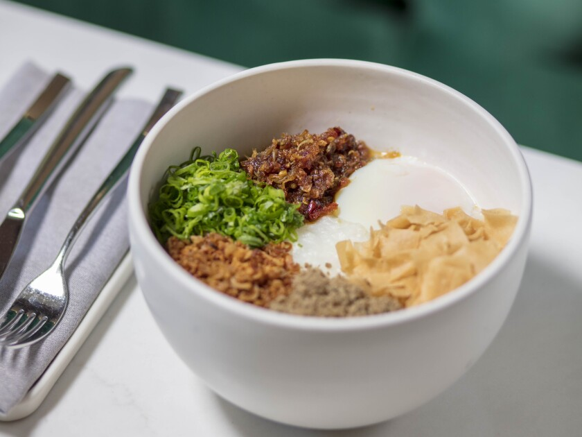 LOS ANGELES, CALIFORNIA - APR. 10, 2019: Koshihikari rice congee, xo, pork floss, and onsen egg fro