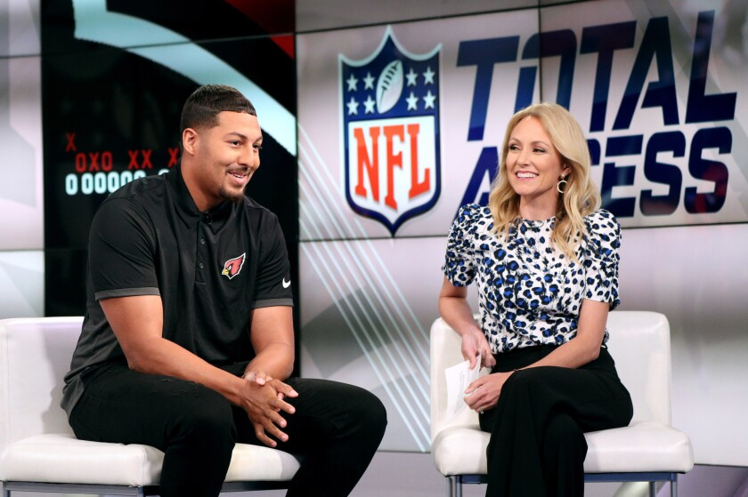 Mr. Irrelevant Caleb Wilson, the last player chosen in the 2019 NFL Draft by the Arizona Cardinals, is interviewed by NFL Total Access host Lindsay Rhodes at NFL Network in Culver City on Tuesday.
