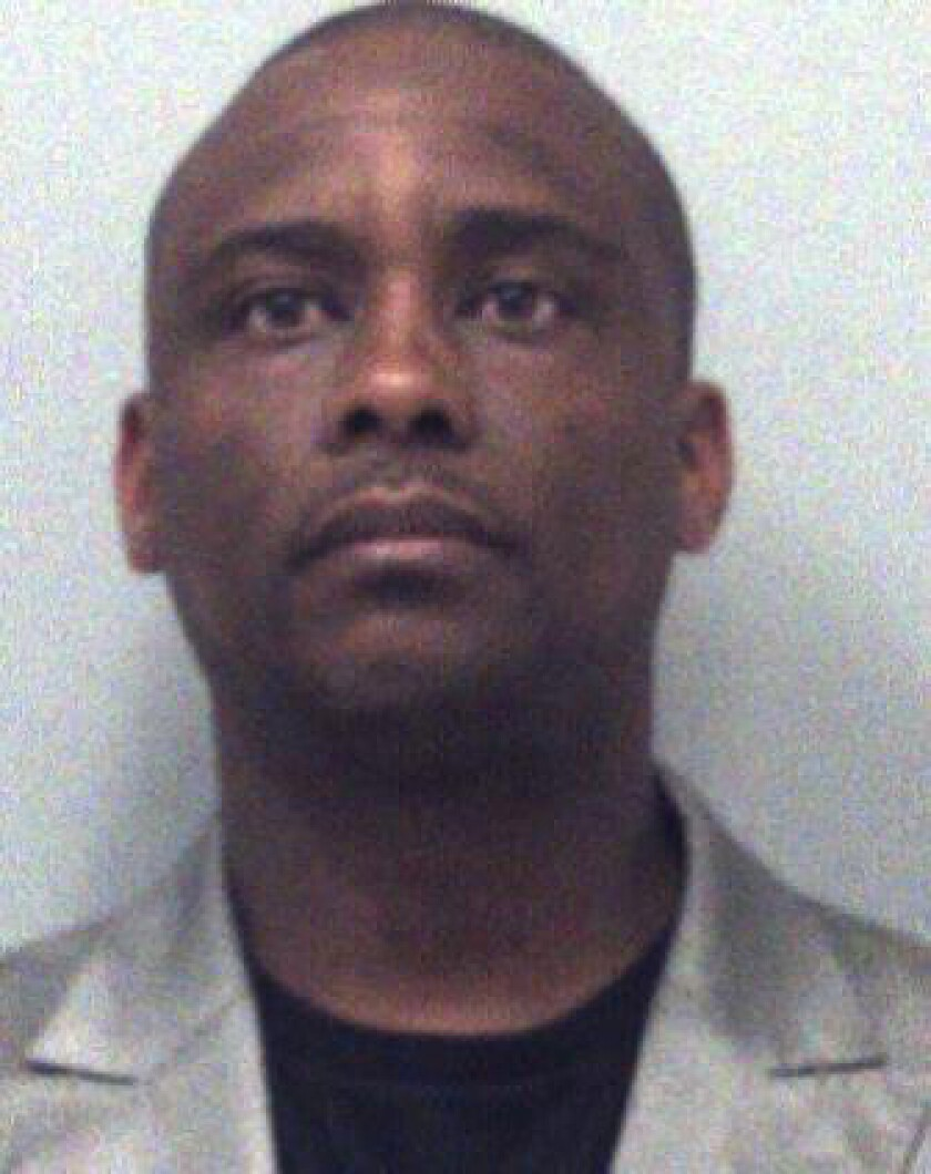 FILE - This undated file photo provided by the Gwinnett County Sheriff's Department shows Clayton County Sheriff Victor Hill. Georgia's governor on Wednesday, June 2, 2021, suspended Sheriff Hill who is accused of violating the civil rights of several people in his custody by ordering them unnecessarily strapped into restraint chairs and left there for hours. A federal grand jury in April indicted Clayton County Sheriff Hill. The indictment accuses the sheriff of improperly using restraint chairs at the county jail for punishment. (Gwinnett County Sheriff's Department via AP)