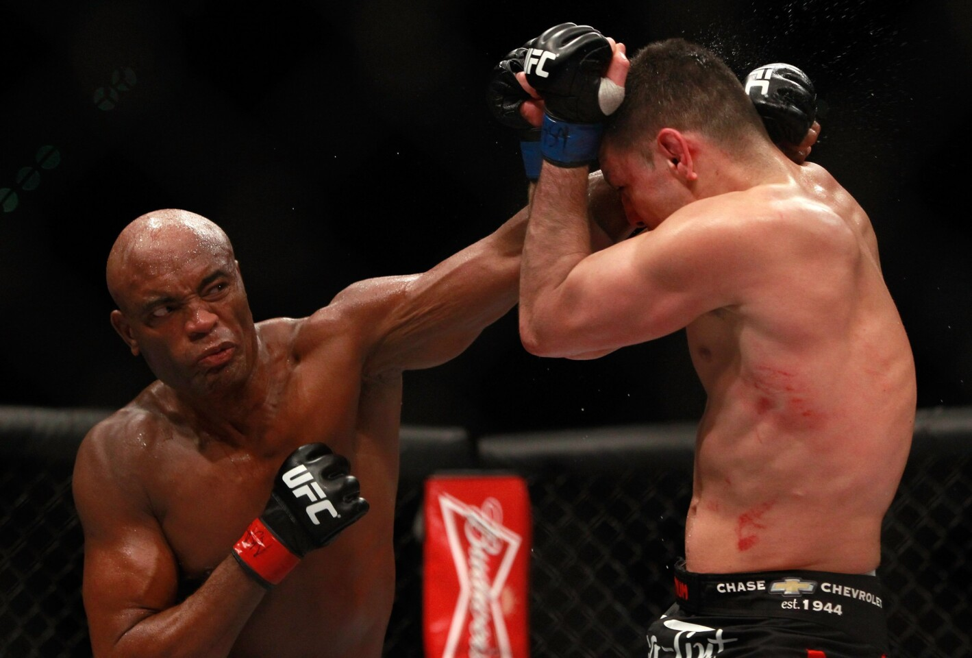 Anderson Silva lands a punch against Nick Diaz during their middleweight fight at UFC 183 on Saturday night at the MGM Grand Garden Arena in Las Vegas.