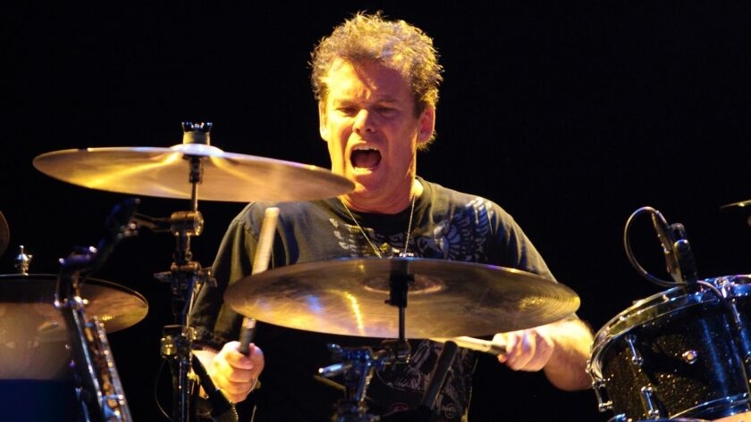 Drummer Glenn Symmonds, shown performing with the Eddie Money Band in 2013, later sued the band's leader after he was replaced.