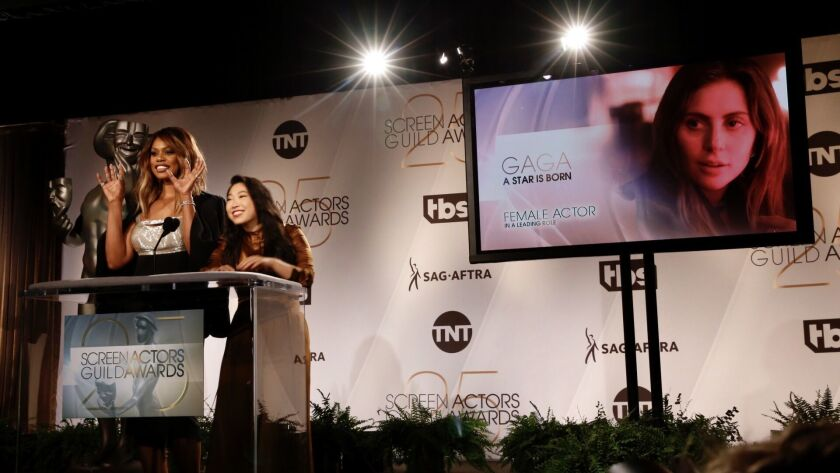 Actresses Laverne Cox, left, and Awkwafina, right, announce nominees for the 25th annual Screen Acto