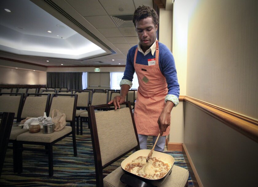 """Nicholas Hebert prepares jambalaya while waiting to audition for the TV competition cooking show, """"MasterChef,"""" at the Westin San Diego Hotel."""
