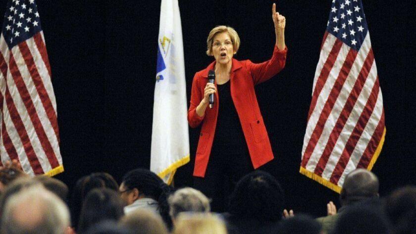 Sen. Elizabeth Warren (D-Mass.) addresses a town hall meeting in Roxbury, Mass., on Oct. 13.