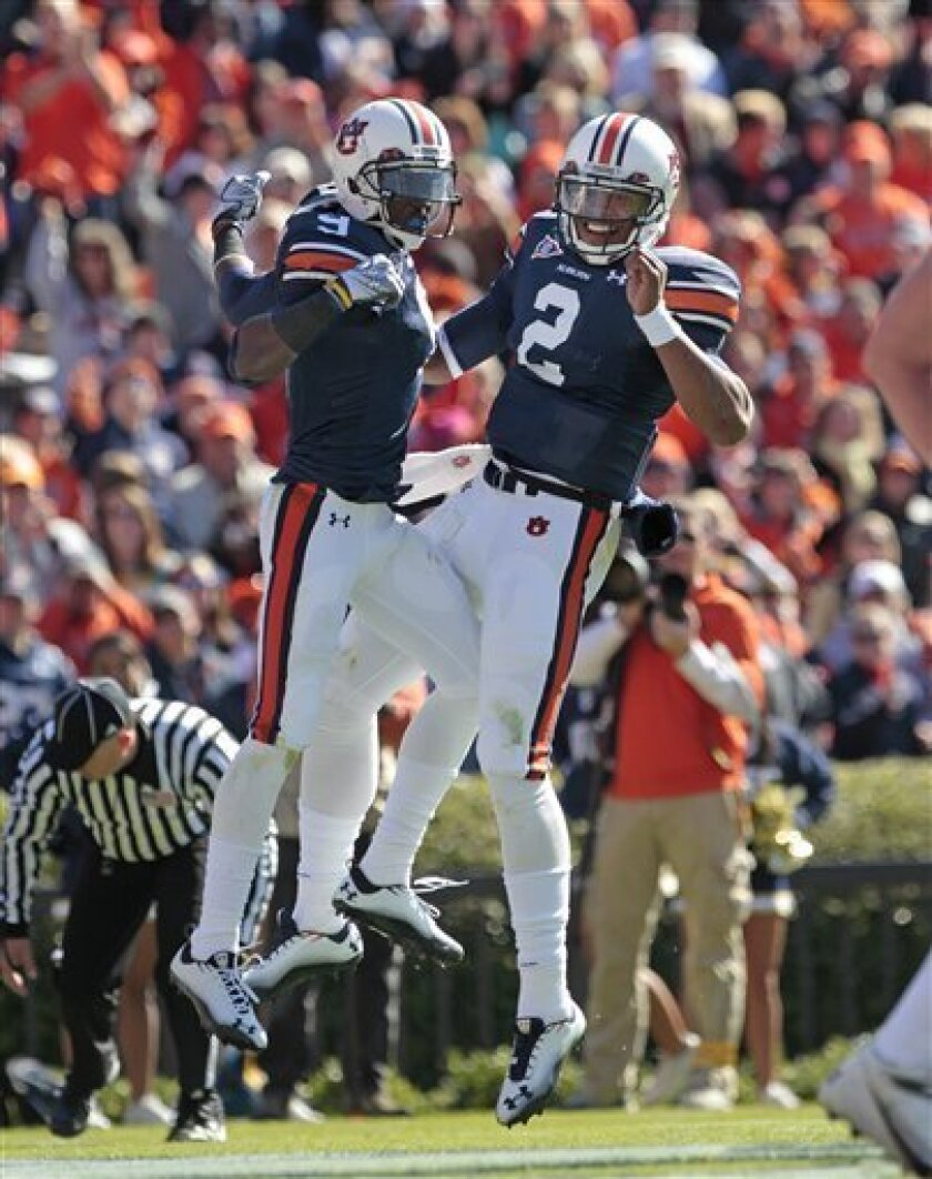 Auburn quarterback Cameron Newton (2) reacts with teammate Quindarius Carr (9) after he scored on a 1-yard run against Chattanooga in the first half of an NCAA college football game Saturday, Nov. 6, 2010 at Jordan-Hare Stadium in Auburn, Ala. (AP Photo/Dave Martin)