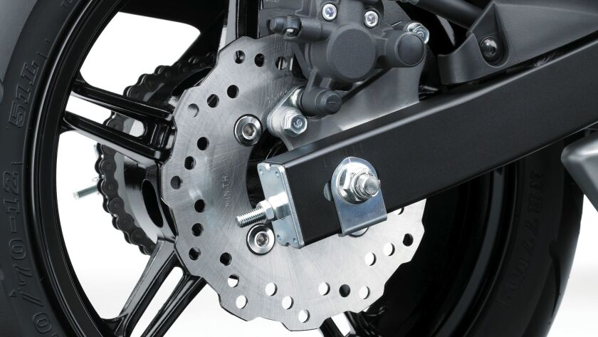 Petal-edged disc brakes are adequate for the wet weight of 225 pounds.