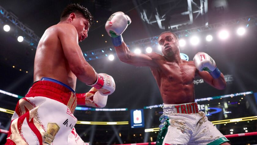 Errol Spence Jr. throws a punch during his welterweight title fight against Mikey Garcia on Saturday night.