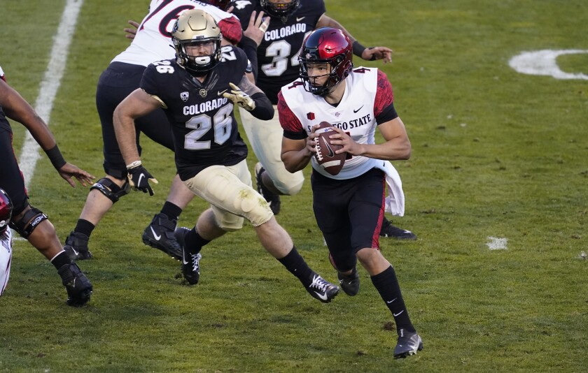 Colorado linebacker Carson Wells pursues San Diego State quarterback Jordon Brookshire in Saturday's game at Folsom Field.