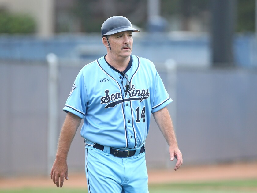 Longtime Corona del Mar baseball coach John Emme, shown after managing his last game for the Sea Kings in 2018, died Monday.