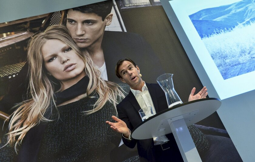 Karl-Johan Persson, CEO of Swedish fashion retailer Hennes and Mauritz (H&M), presents the company's interim report for the third quarter during a news conference in Stockholm, Thursday Sept. 24, 2015. H&M sales recovered in September after a weak August. (AP Photo/Jonas Ekstromer) SWEDEN OUT