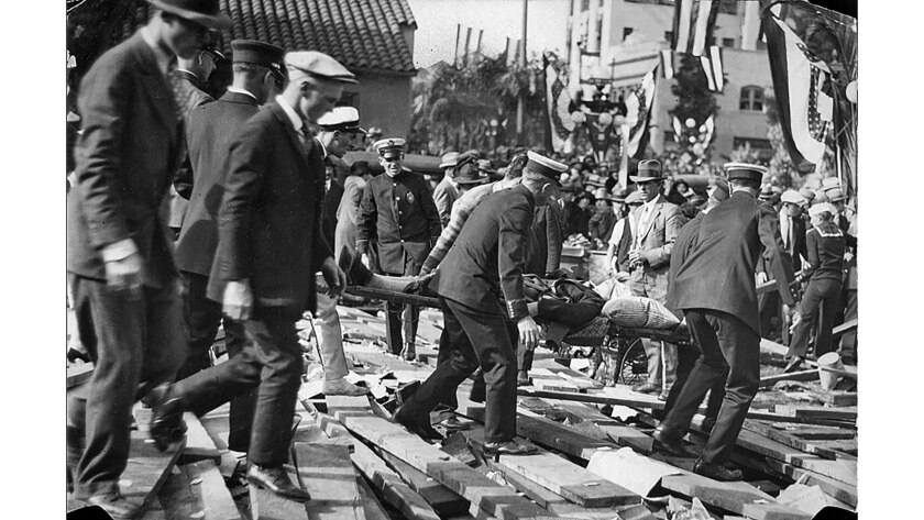Jan. 1, 1926: A victim is removed after the collapse of a Rose Parade grandstand at Colorado Boulevard and Madison Avenue in Pasadena. Eleven people died.