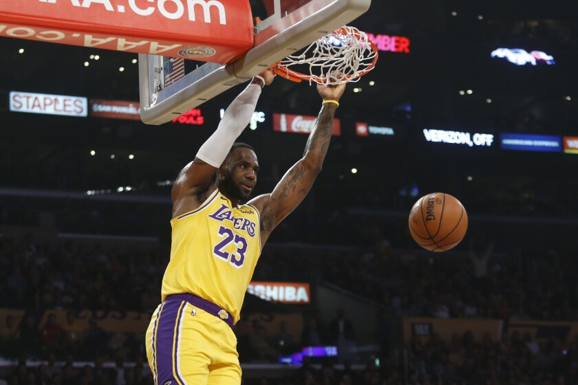 Lakers' LeBron James dunks during the first half against the Oklahoma City Thunder on Tuesday at Staples Center.