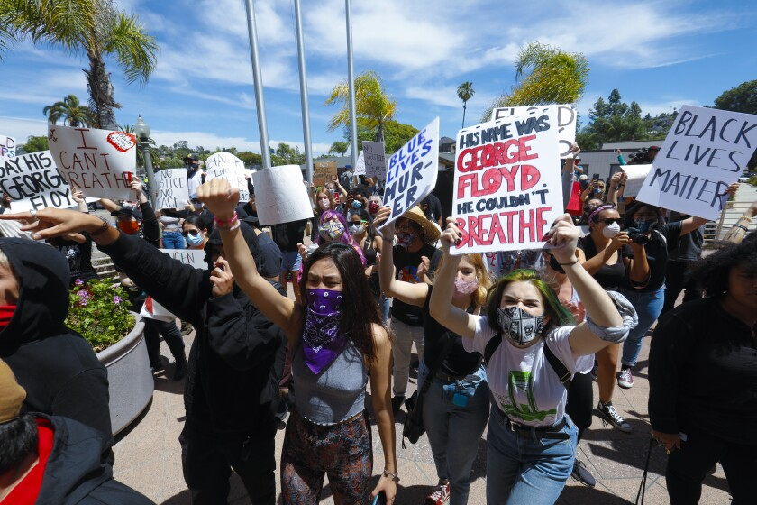 Protesters gather in front of the La Mesa Police Department last Saturday.