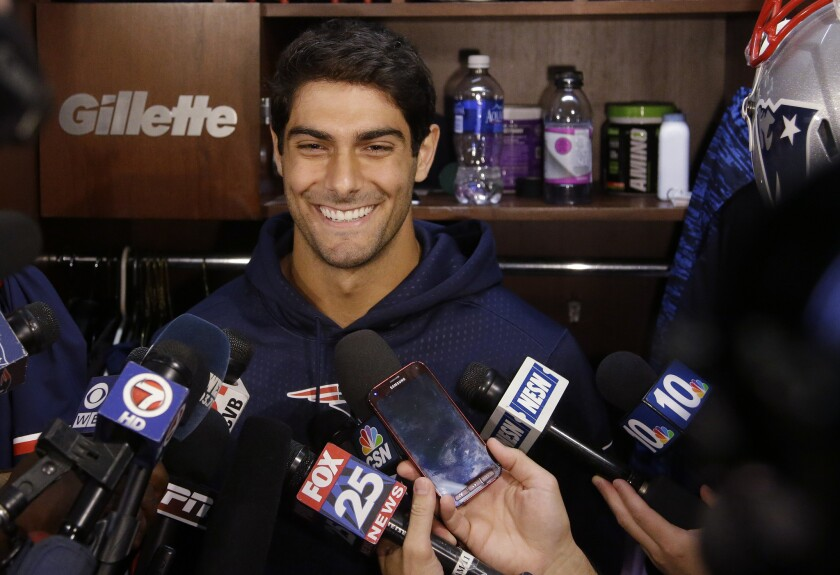 New England quarterback Jimmy Garoppolo talks to reporters on Sept. 1, 2015.