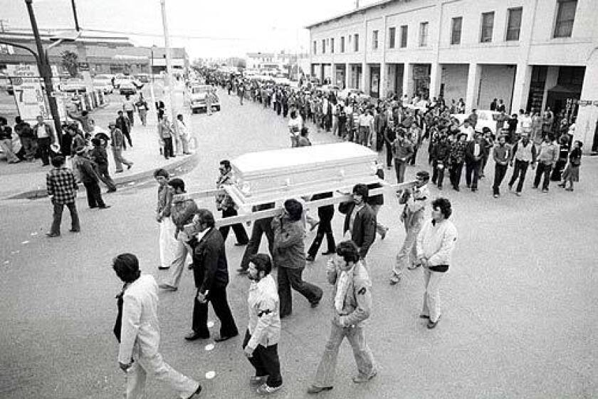 Pallbearers carry Rufino Contreras' casket through Calexico, Calif., on Feb. 14, 1979, leading a crowd of 7,000 mourners who walked three miles to the cemetery. Contreras had been gunned down four days earlier when he and others went into the fields to try to persuade strike-breakers to stop working.