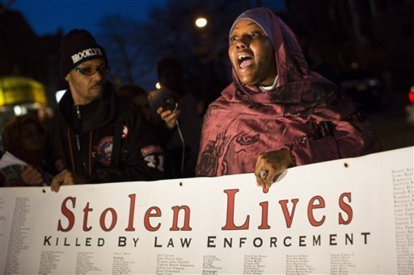 """Demonstrator Fatimah Shakur speaks during a vigil held for Kimani """"Kiki"""" Gray in the East Flatbush neighborhood of Brooklyn, Wednesday, March 13, 2013, in New York. The 16-year-old was shot to death on a Brooklyn street last Saturday night by plainclothes police officers who claim the youth pointed"""
