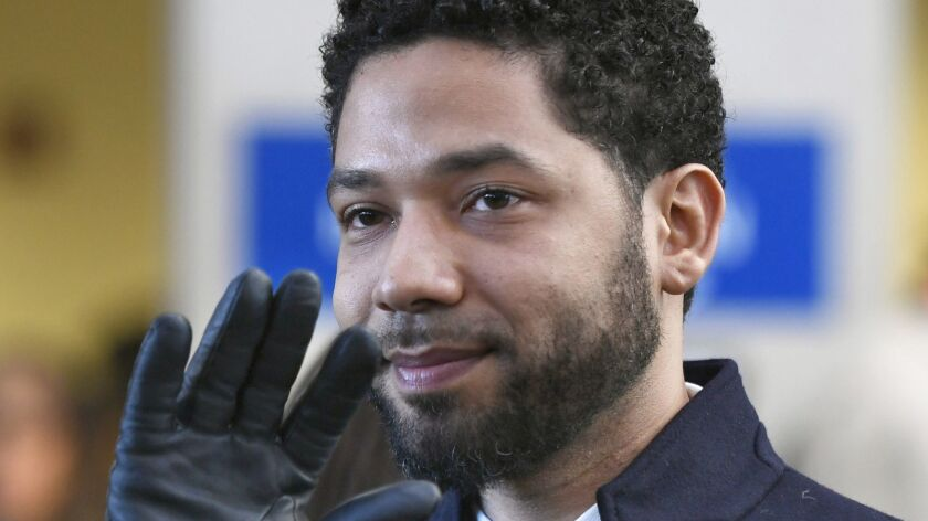 FILE - In this March 26, 2019, file photo, actor Jussie Smollett smiles and waves to supporters befo