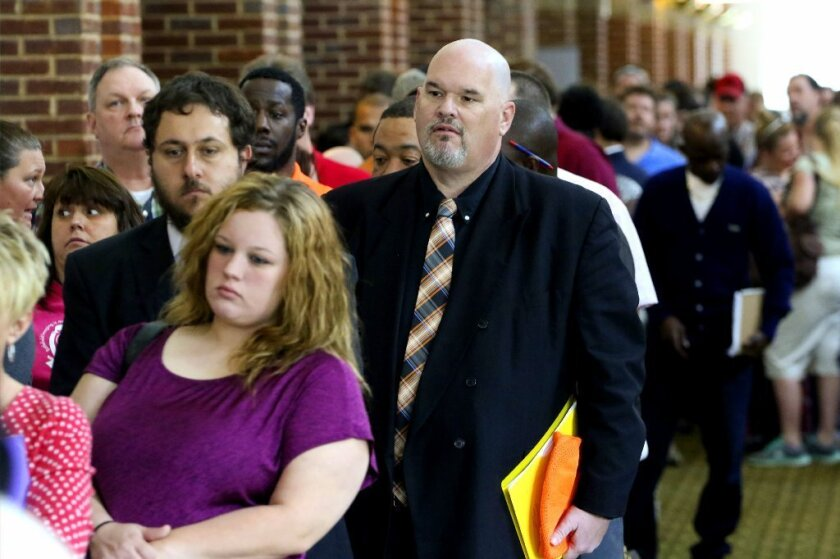 Hundreds of job seekers wait in line at a job fair in Ringgold, Ga.