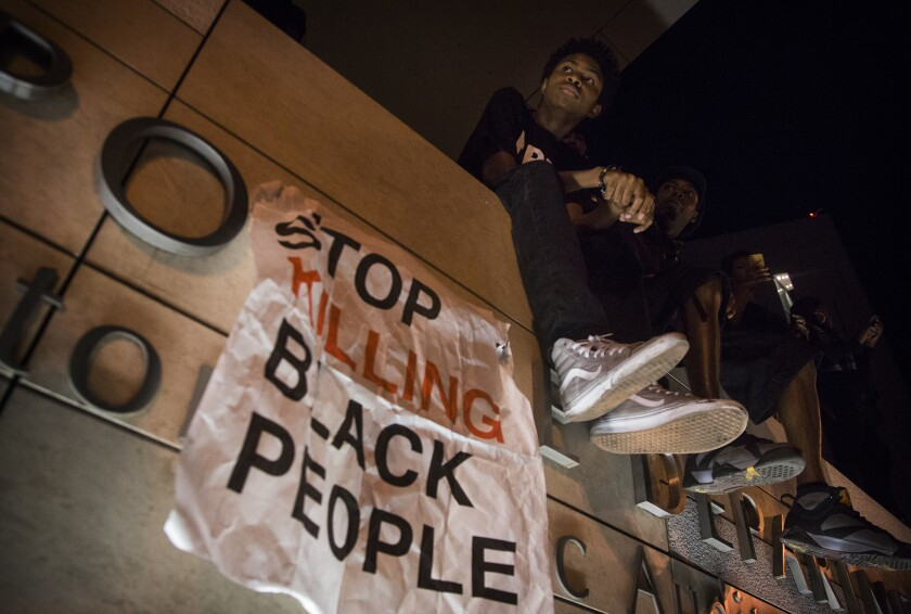 Justin Mullen listens to a speaker outside LAPD headquarters during a Black Lives Matter protest.