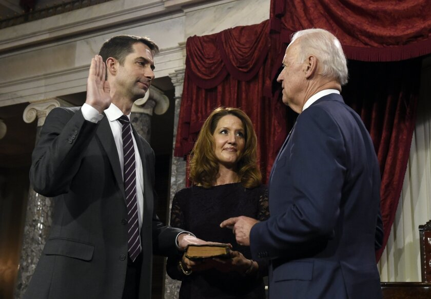 Vice President Joe Biden administers the Senate oath to Sen. Tom Cotton R-Ark.,  during a ceremonial re-enactment swearing-in ceremony, Tuesday, Jan. 6, 2015, in the Old Senate Chamber on Capitol Hill in Washington. Cotton's wife Anna is at center. (AP Photo/Susan Walsh)
