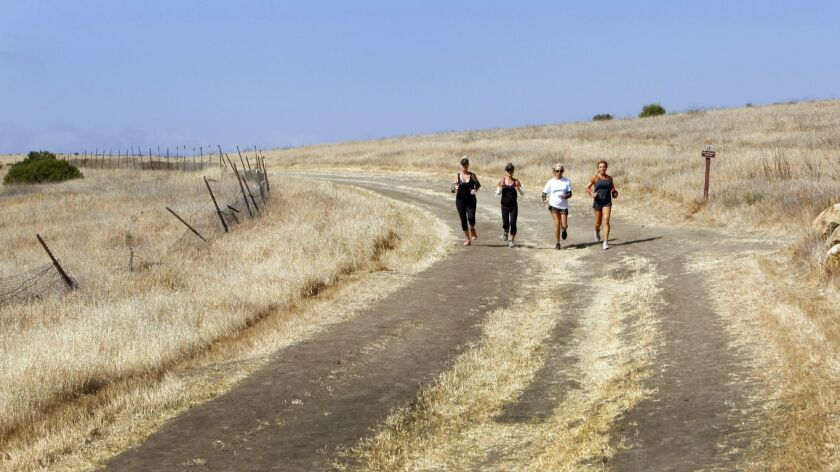 HIDDEN HILLS, CA-MAY 01, 2013: Ultra-marathon runner Shannon Farar-Griefer, right, works out runni