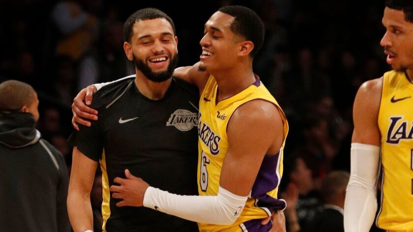 Lakers guard Jordan Clarkson (6) gets a hug from teammate Tyler Ennis (10) after his three-pointer seals the win against the Indiana Pacers at Staples Center on Jan. 19.