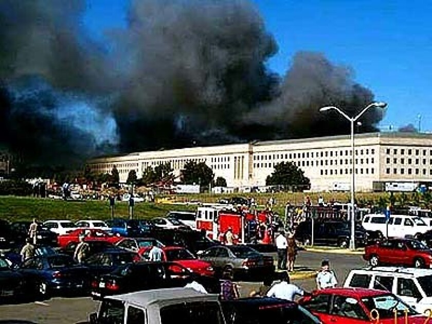 Smoke and flames rise above the Pentagon during the terrorist attacks of Sept. 11, 2001.