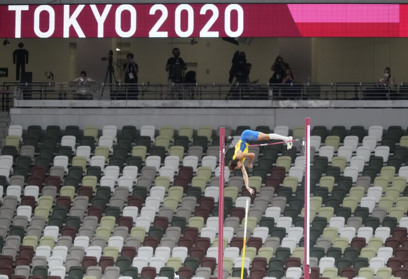 Armand Duplantis, of Sweden fails with the world record attempt after winning the gold in the final of the men's pole vault at the 2020 Summer Olympics, Tuesday, Aug. 3, 2021, in Tokyo. (AP Photo/Martin Meissner)