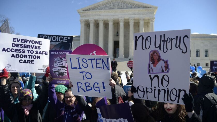 Supporters of legal access to abortion rally alongside anti-abortion activists at the U.S. Supreme COurt on March 2, 2016.