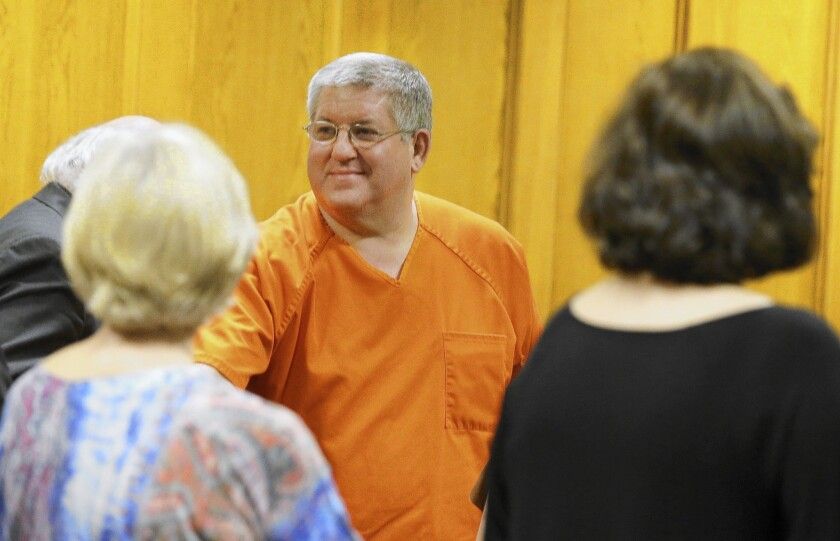 Bernie Tiede, who was serving a life sentence, smiles at the courthouse in Panola County, Texas, after a judge granted his release.