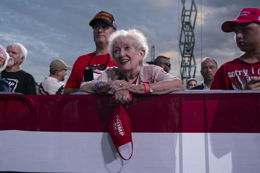 Supporters of President Donald Trump listen as he speaks during a campaign rally at Cecil Airport, Thursday, Sept. 24, 2020, in Jacksonville, Fla. (AP Photo/Evan Vucci)