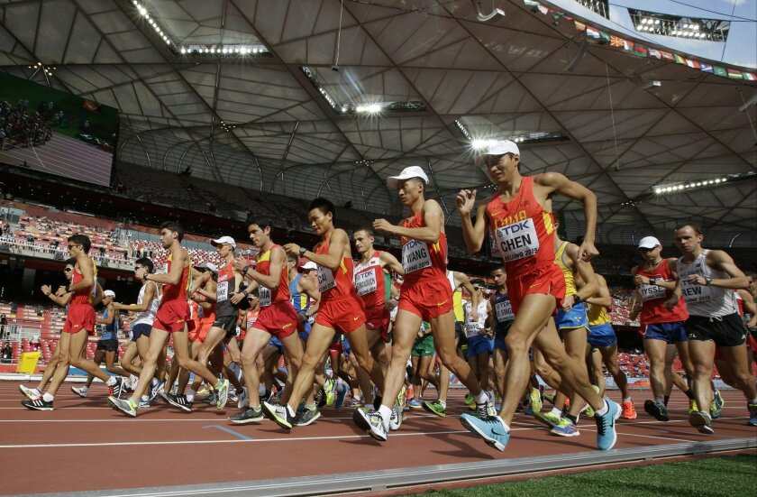 Competitors start the men's 20k race walk final at the World Athletics Championships at the Bird's Nest stadium in Beijing, Sunday, Aug. 23, 2015. (AP Photo/Lee Jin-man)