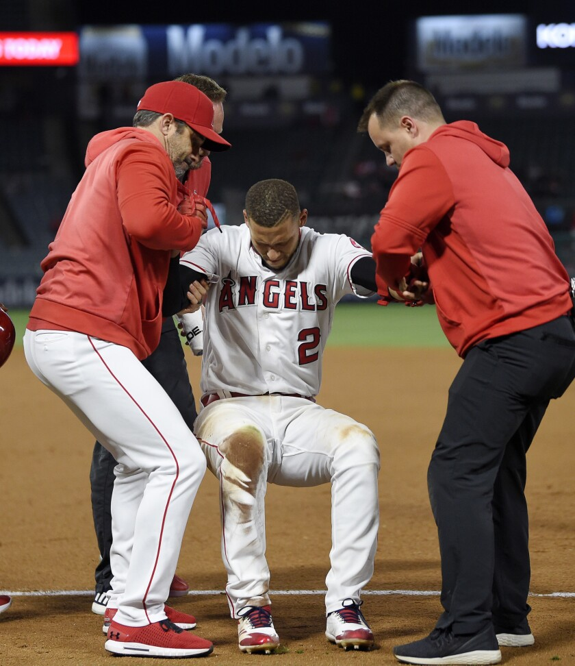 Angels' Andrelton Simmons is helped up after injuring an ankle in May 2019. He also injured an ankle Monday.