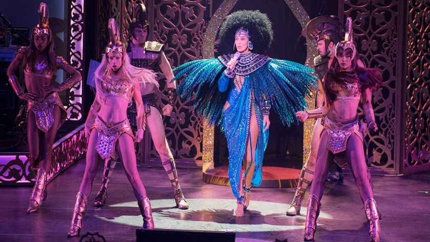 """Cher, surrounded by a troupe of dancers and musicians, makes several costume changes during her """"Classic Cher"""" show."""