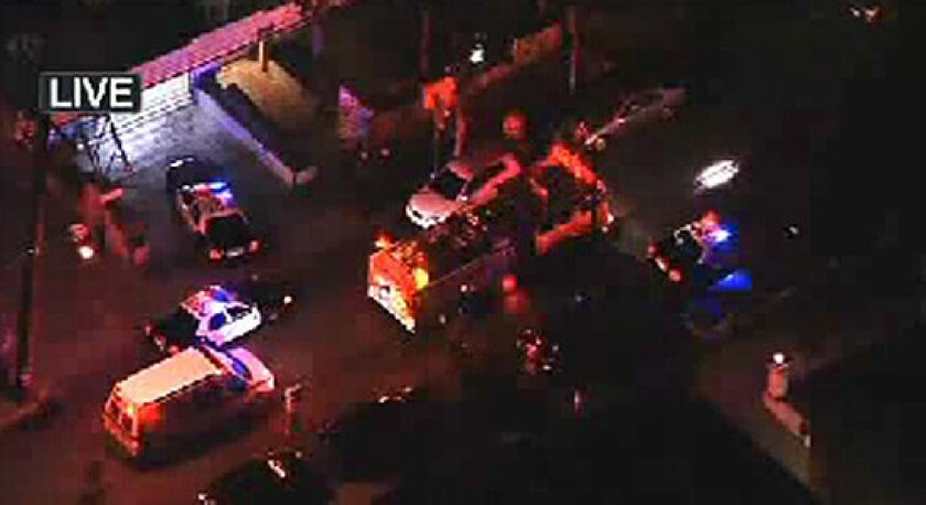 Emergency vehicles at the scene of the shooting.