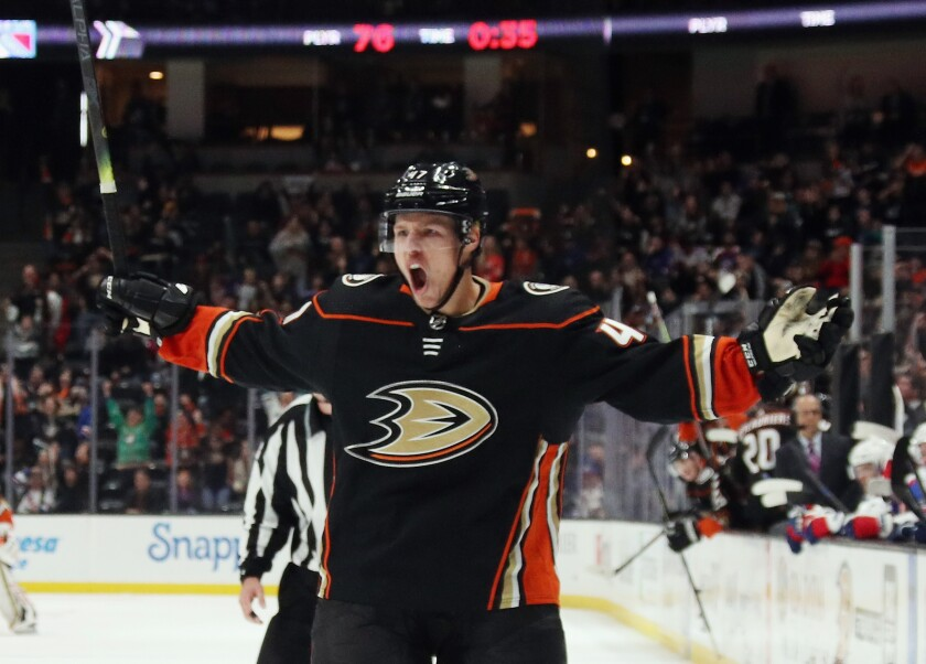 The Ducks' Hampus Lindholm celebrates his power-play goal that tied the score late in the third period.