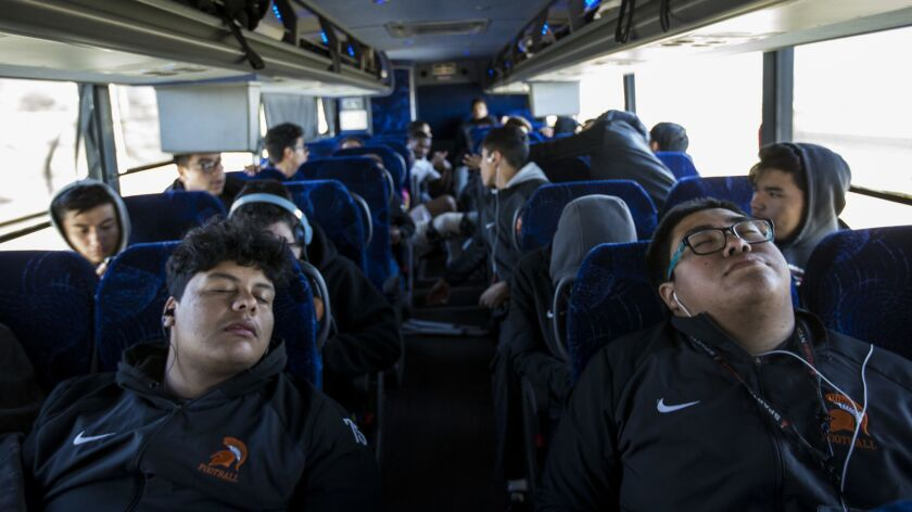 LOS ANGELES, CA - DECEMBER 09: Students nap as the the Huntington Park Spartans take a 4 hour bus ri