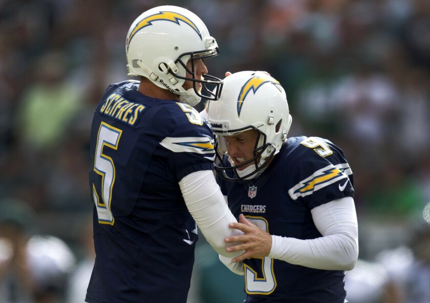 The high altitude of Denver, the Broncos and a playoff game await Chargers punter Mike Scifres, left, and placekicker Nick Novak.