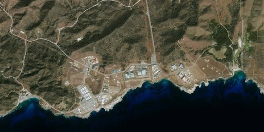 A new satellite image of the Guantanamo Bay prison facility, supplied by GeoEye, was collected by an  IKONOS satellite on Jan. 1, 2009, from 423 miles in space as the satellite moved over the Caribbean from north to south at 17,000 mph. Advisers to President-elect Barack Obama say Monday, Jan. 12,