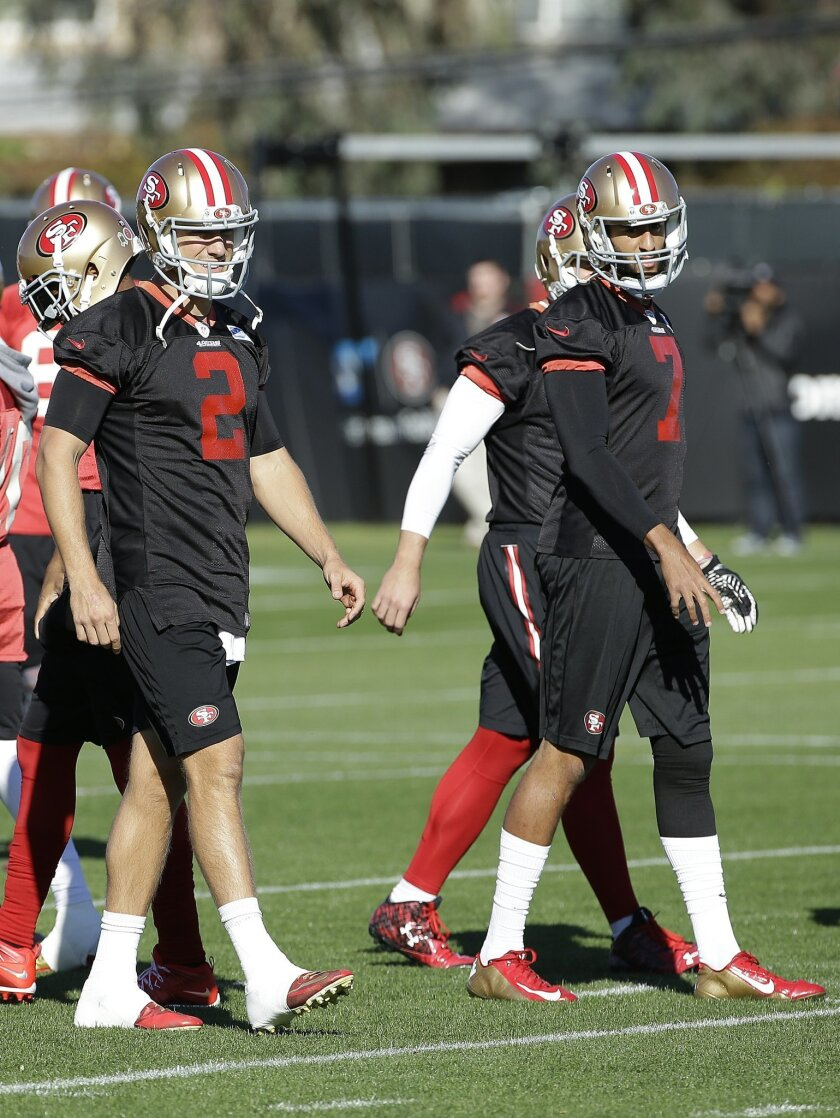 San Francisco 49ers quarterback Blaine Gabbert (2) and quarterback Colin Kaepernick (7) participate in drills during an NFL football practice in Santa Clara, Calif., Wednesday, Nov. 4, 2015. Head coach Jim Tomsula announced that the 49ers have officially made the change at quarterback from Kaeperni