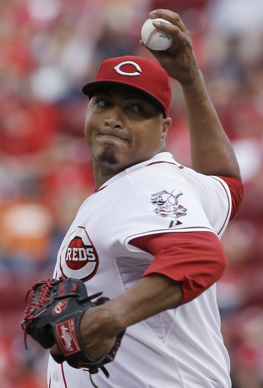 Cincinnati Reds starting pitcher Alfredo Simon throws against the Miami Marlins in the first inning of a baseball game, Saturday, Aug. 9, 2014, in Cincinnati. (AP Photo/Al Behrman)