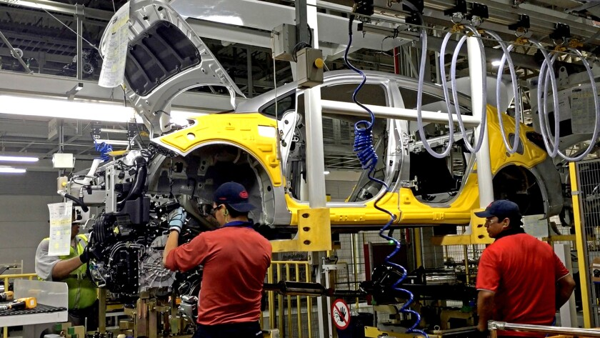 Workers assemble the Forte sedan at a Kia plant in Nuevo Leon, Mexico. Even in Mexico, with its lower labor costs, machines are replacing people.