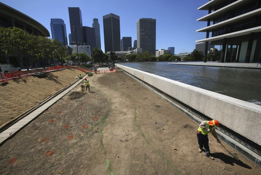 L.A. Department of Water and Power employees prepare ground for a drought resistant garden outside DWP headquarters in downtown Los Angeles. With data in for the most recent rainy season, downtown has seen its lowest four-year rainfall total since record-keeping began in 1877.