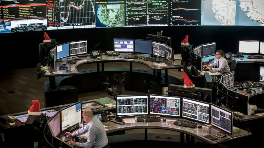 DECEMBER 6, 2017 FOLSOM, CA. Workers in the CAL-ISO control center monitor energy levels and prices
