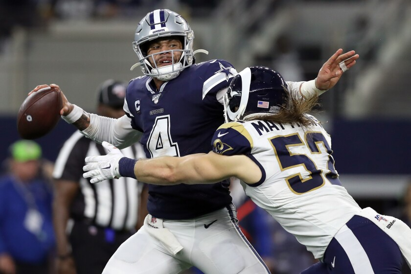 Dallas Cowboys quarterback Dak Prescott is hit by Rams linebacker Clay Matthews during the second quarter of the Cowboys' 44-21 win Sunday.
